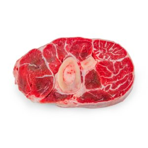 Fresh veal shank meat on white background