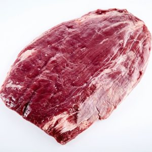 Prime cut of raw matured beef flank steak trimmed of fat ready for grilling or roasting isolated on white